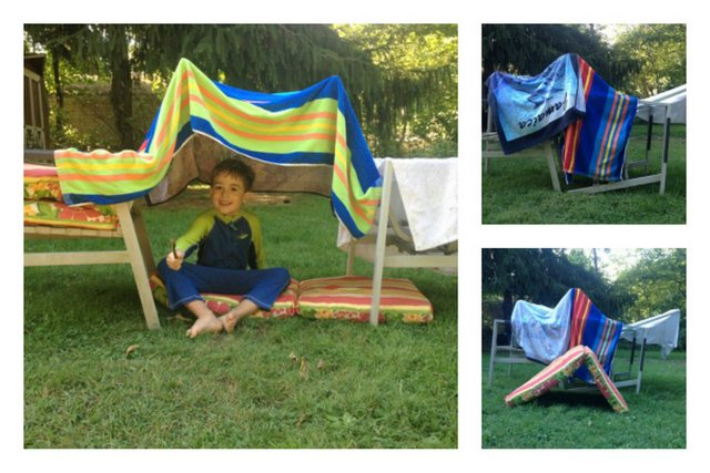 A kids fort made with towels and chairs!