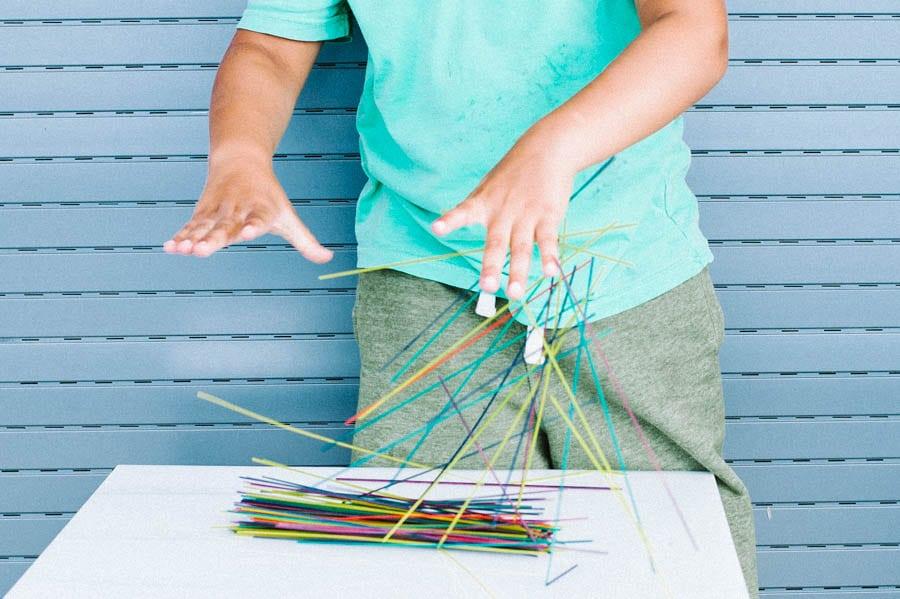 Make spaghetti art with kids.