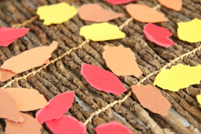 Kids can tear paper to make leaves for a Fall Tree Craft.