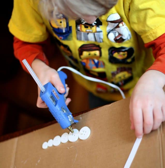 Hot gluing icicle craft