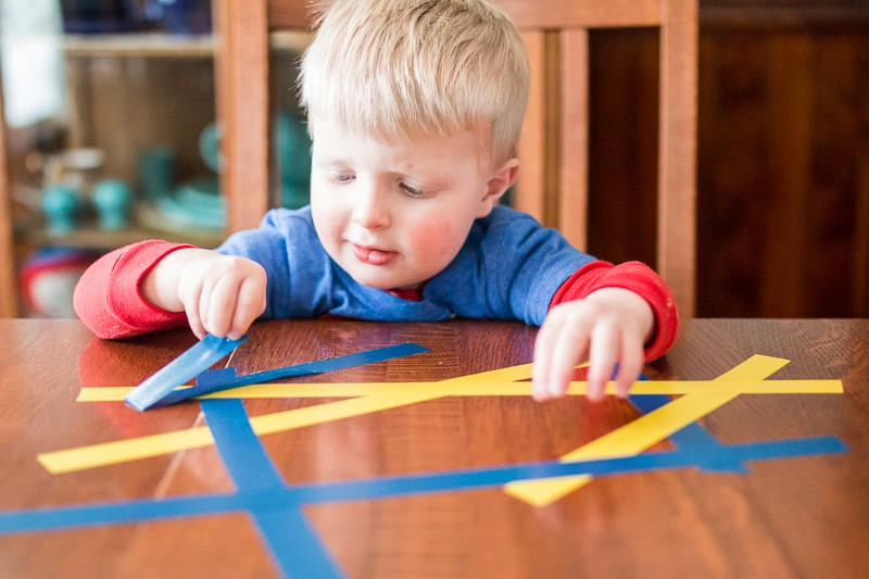 Peel tape off the table (fine motor skills!)