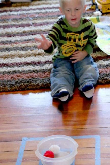 Throwing practice for preschoolers using pom poms