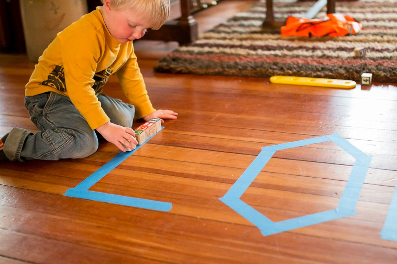 Tracing lines with objects. Toddler style.