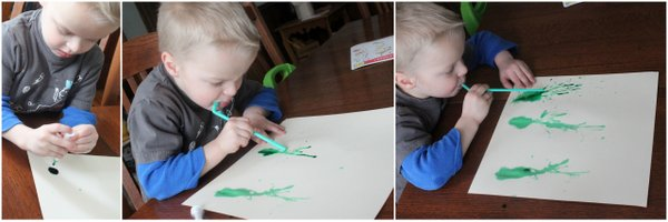 Blowing paint with straws to make a spring flower art project