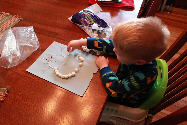 Marshmallow Snowman Craft for kids to make in the winter and work on fine motor skills.