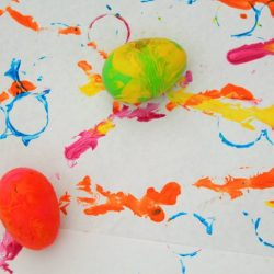 Rolling Egg Painting from hands on : as we grow