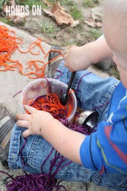 Exploring slimy colored spaghetti