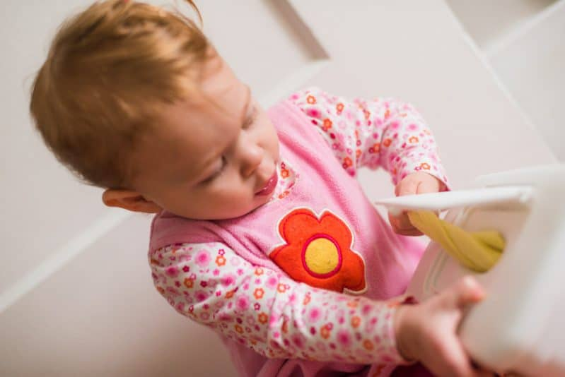 Hours of fun for babies and toddlers with a wipe container and fabric. Simple baby sensory activity