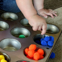 Use pom poms for fine motor activities