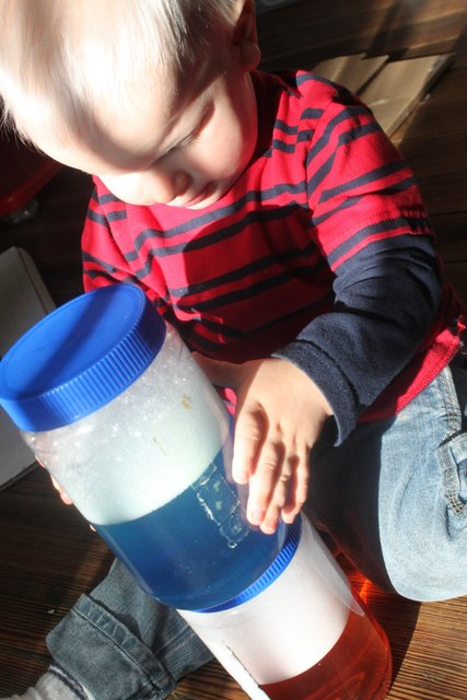 A sensory activity for toddlers - stacking soapy sensory jars