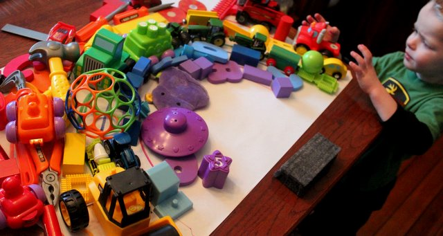 Make a rainbow with toys in all the colors of the rainbow