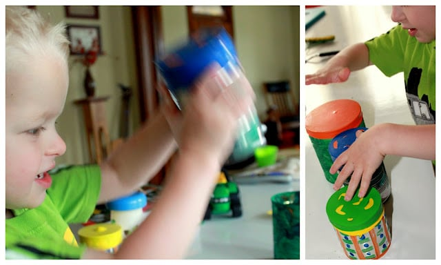 Add pasta, beans, and rice to the tin can drums to make musical shakers