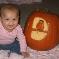 Baby pumpkin play. One of the 40 pumpkin activities for kids.
