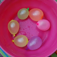 Water balloon play to beat the heat!