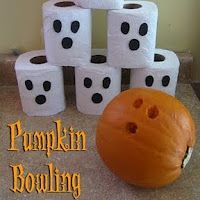 Pumpkin bowling. One of the 40 pumpkin activities for kids.