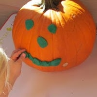 Playdough pumpkin faces.