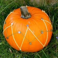Nail and thread. One of the 40 pumpkin activities for kids.