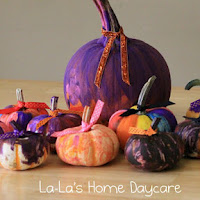 Painting pumpkins. One of the 40 pumpkin activities for kids.