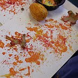 Painting with pumpkins.