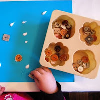 Use buttons for fine motor activities