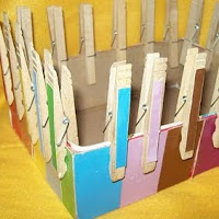 Match colors with clothespins for fine motor skills