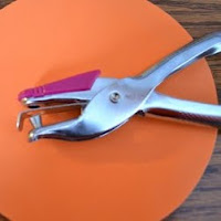 Use a hole punch for fine motor skills