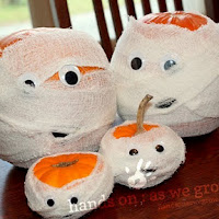Mummy family of pumpkins. One of the 40 pumpkin activities for kids.