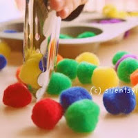 Use the kithcen tongs in fine motor activities
