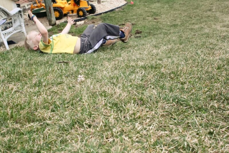 Rolling down the hill is one of our favorite outdoor play activities!