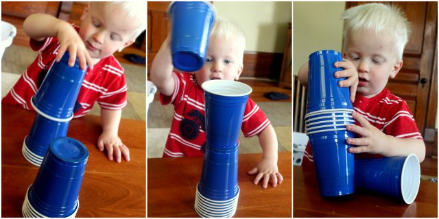Toddler stacking cups in different ways