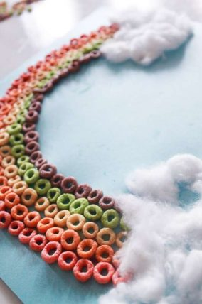 Make a colorful Cheerio rainbow craft with the kids