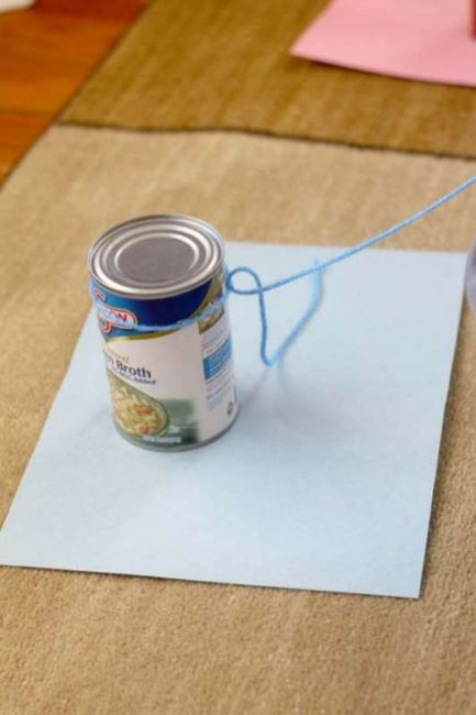 Tie the yarn onto a canned food to begin connecting the colors!