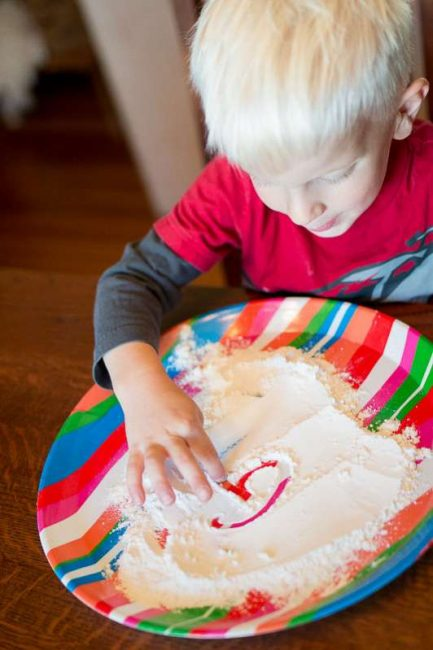 Making marks in flour for prewriting -- simple practice for preschoolers!