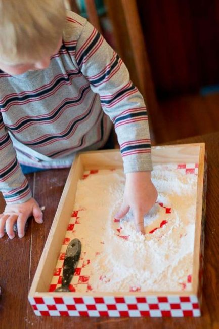 Making marks in flour for prewriting -- simple idea for toddlers!
