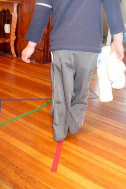 Walk and balance on lines of colored tape