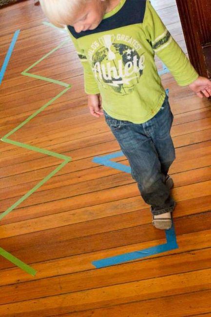 Walk the lines of colored tape! Can you balance?