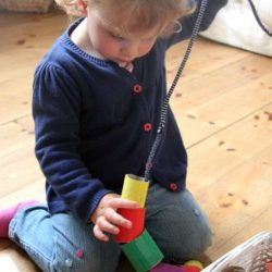 Toddler-threading-activity-with-giant-cardboard-beads[1]