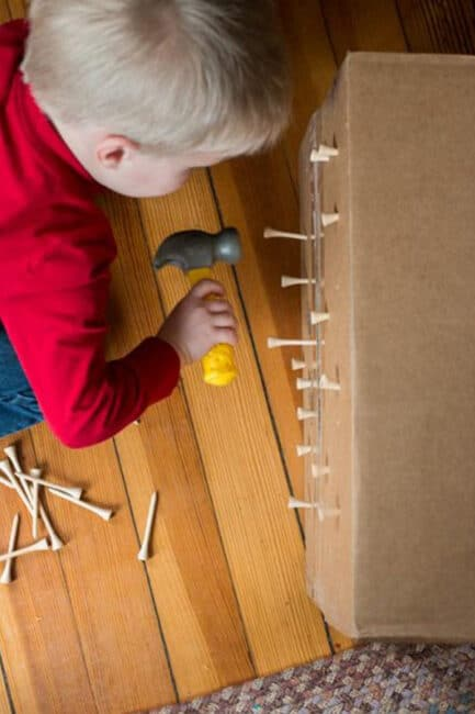 Keep your toddler busy with a fun and easy hammering tees into a box activity