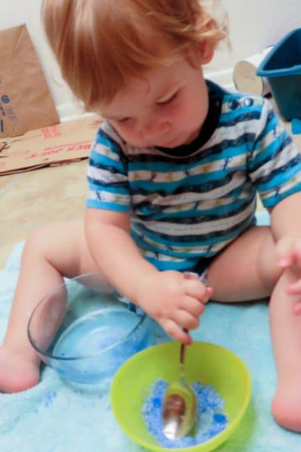 Make a salt soak into a simple sensory activity for little ones to soak their hurt finger