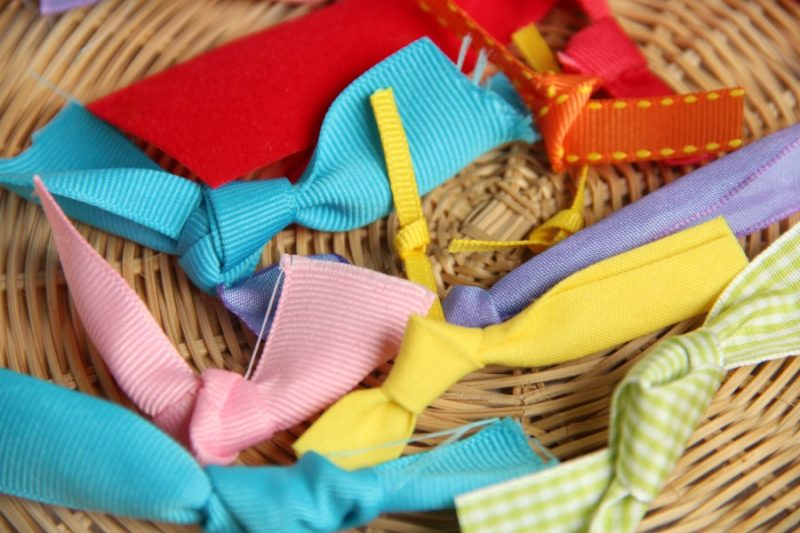 Use scrap ribbons for a fine motor knot tying activity.