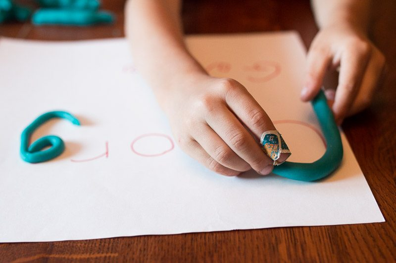 Strengthen hands and learn their name with simple name tracing with play dough!
