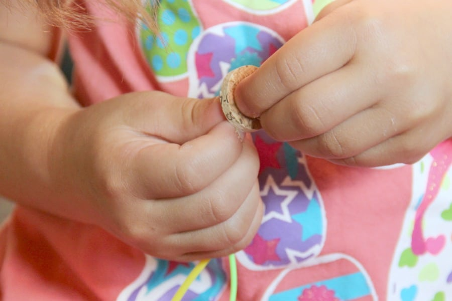 Cork Bead Bracelets are fun to make using cork to create beads for fine motor threading that kids will love.