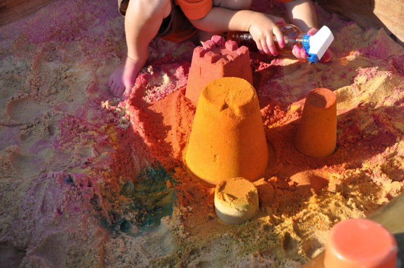 Sandbox Activities for Kids -- Make colored sand castles. Let the kids use spray bottles in the sandbox to create colorful sand creations. Play at Home Mom shares her tips for making the colors.