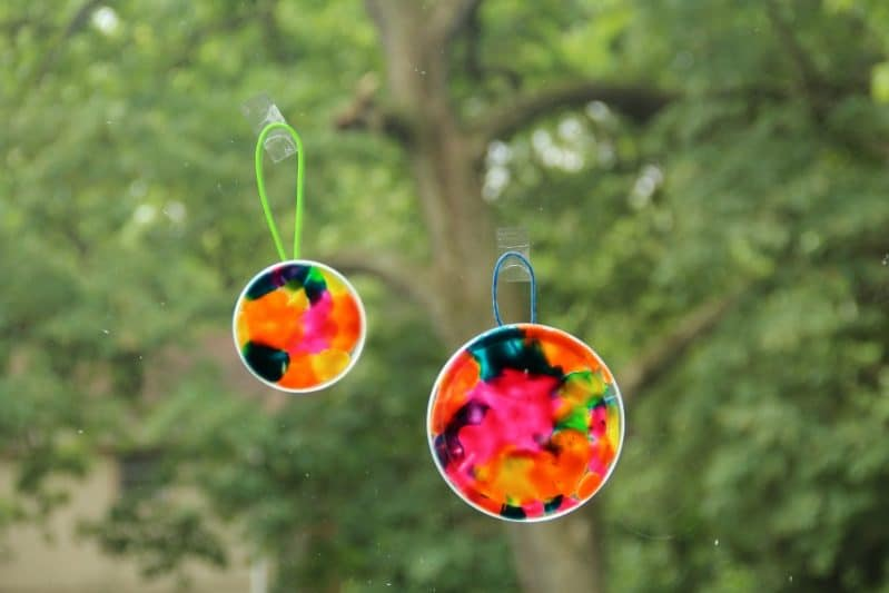 Play dough suncatcher craft uses playdough and builds fine motor skills.