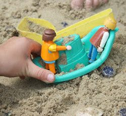 Take your toys to a mini beach in the sandbox!