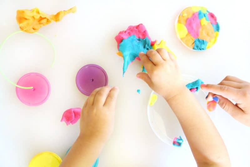 Use colorful play dough to make a play dough suncatcher craft with the kids.
