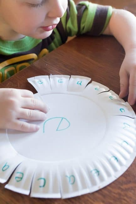 Using a paper plate to practice learning a couple of letters -- so easy to set up!
