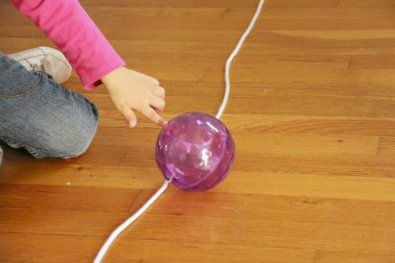 This follow the line motor planning activity uses a ball and a rope to develop many skills.