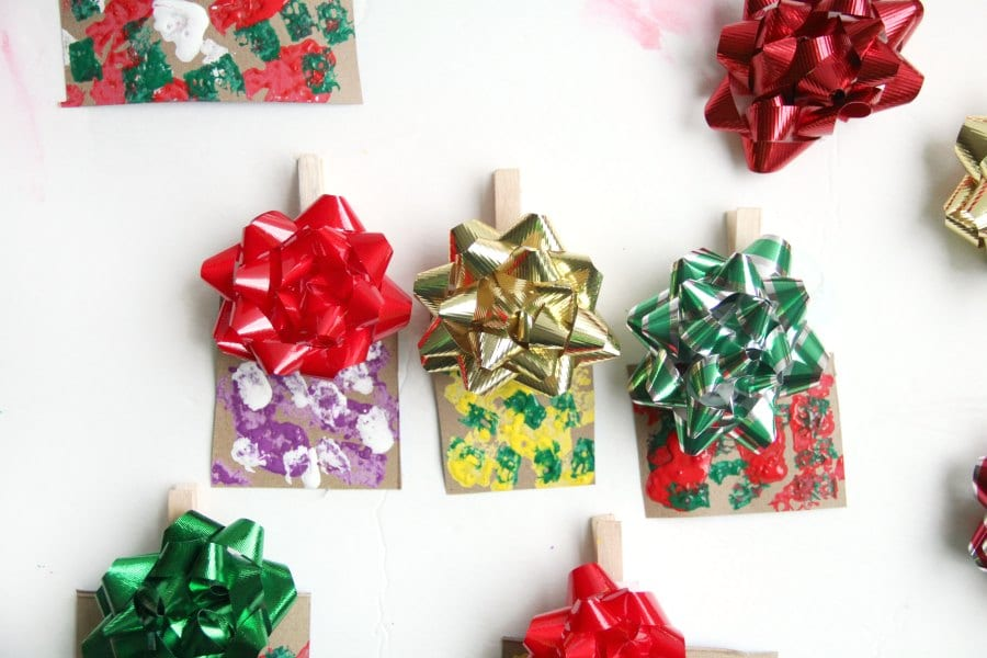 Make a present Christmas tree ornament craft this year with the kids.