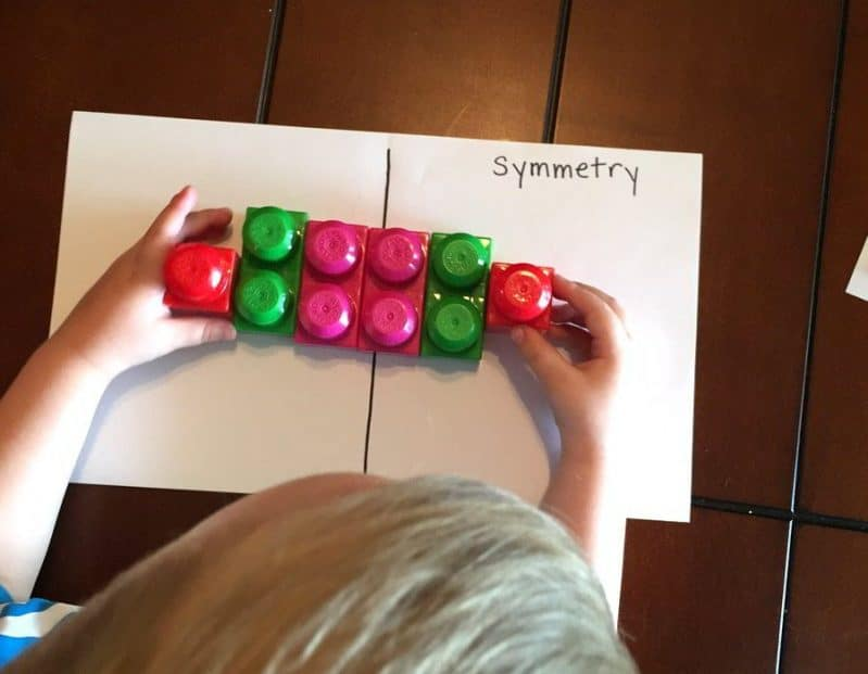 This is a super easy, hands-on preschooler activity for learning symmetry. Explore symmetry in nature and create symmetrical images with blocks and toys!